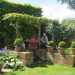 Guests find a secluded corner of the garden